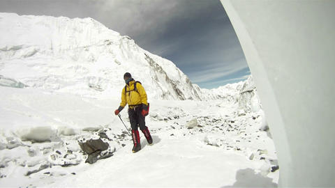 Climber passing by on way to camp Stock Video Footage