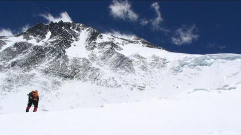 Climber walking towards Everest Stock Video Footage