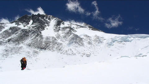 Climber walking towards Everest Stock Video Footage