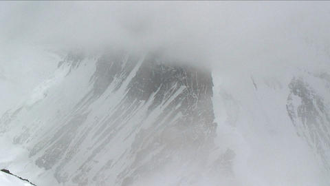 Climber, climbing through snow and fog Stock Video Footage