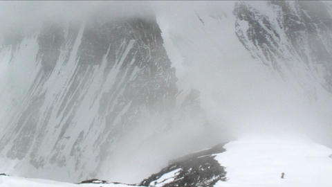 Climber, climbing through snow and fog Footage