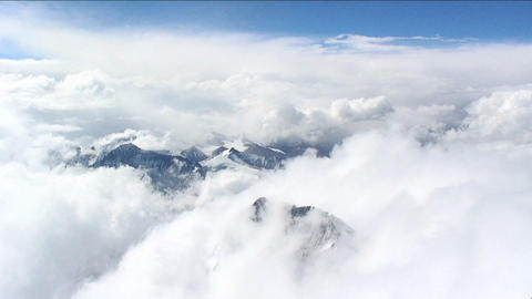 Looking down through clouds to Tibet Stock Video Footage