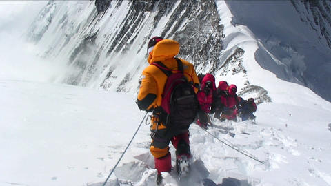 Climbers stuck and turning back in high winds Stock Video Footage