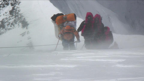 Climbers battered by strong winds Stock Video Footage