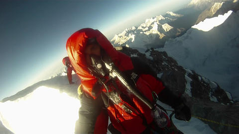 Morning sun hitting climbers near step Footage