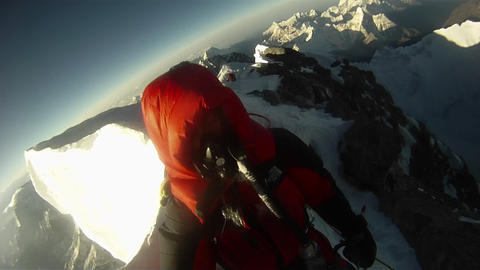 Morning sun hitting climbers near step Stock Video Footage