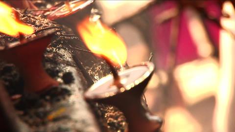 Lighting prayer candles, dragged shutter Footage