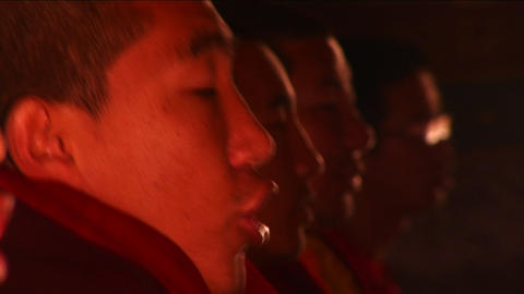 Monks in temple chanting Stock Video Footage