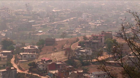 Pan of houses on outskirts of Kathmandu Stock Video Footage