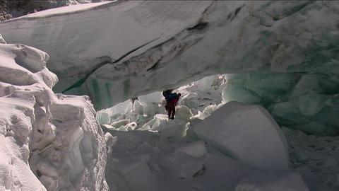 Climbers navigate under larger serac Footage