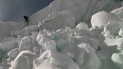 Climber using ladder in the icefall Footage