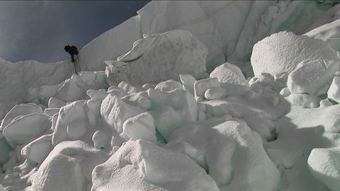 Climber using ladder in the icefall Stock Video Footage