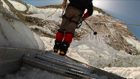 Close-up of crampons on ladder rungs Footage