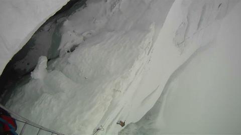 Sherpa crossing diagonal ladder Stock Video Footage