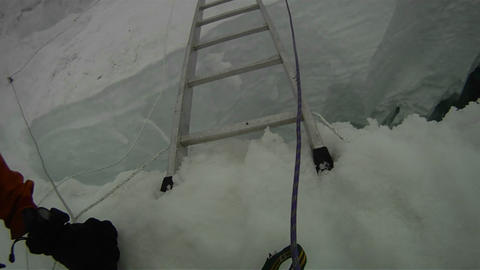 POV of ladder crossing over crevasse Stock Video Footage