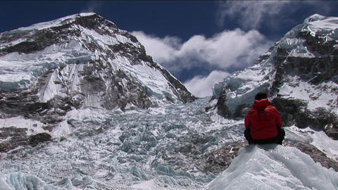Climber sitting looking out at Khumbu icefall Stock Video Footage