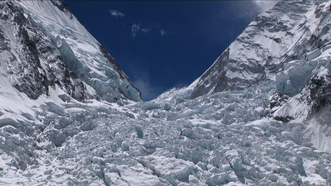 Pan up of Khumbu icefall from basecamp Stock Video Footage