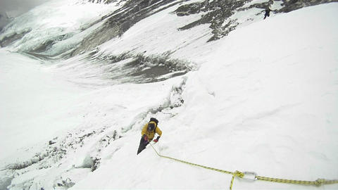 Climber making his way up using ropes Stock Video Footage