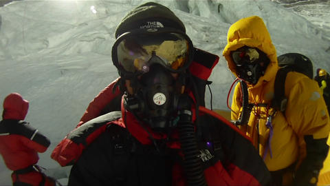 Climbers about to leave camp three Stock Video Footage