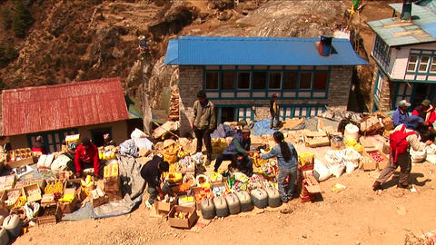 Man selling goods in medium shot of Namche Market Stock Video Footage