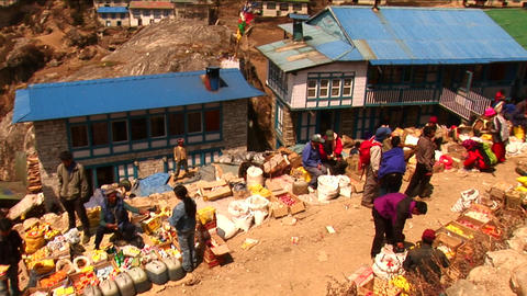Man selling goods in medium shot of Namche Market Footage