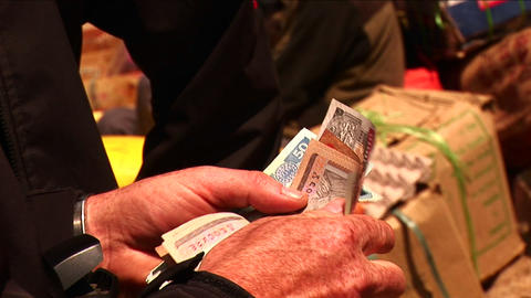 Counting money to give to vendor in a Himalayan market. Stock Video Footage