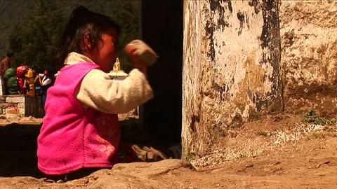 Little nepalese girl playing with stone in Kathmandu Nepal. Footage