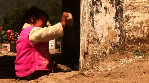 Little nepalese girl playing with stone in Kathmandu Nepal. Stock Video Footage
