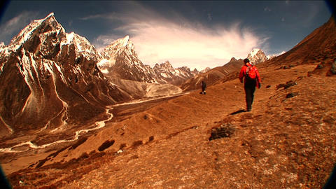Wide shot of trekker near Dukla on Mt. Everest. Footage