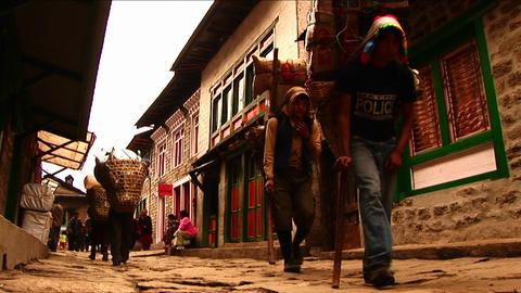 Porters walking through Lukla. Stock Video Footage