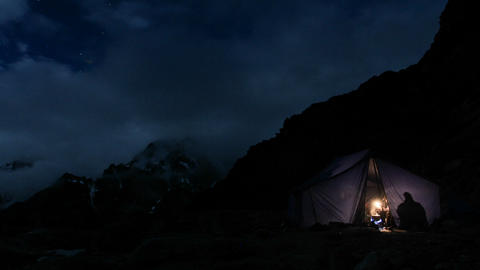Tent at night climbers in and out Stock Video Footage
