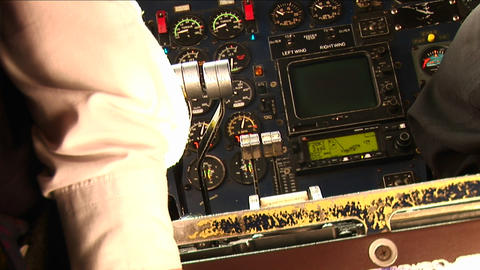 Pilots hands on the controls of an small airplane landing. Stock Video Footage