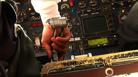 Pilots hands on the controls of an small airplane landing. Footage