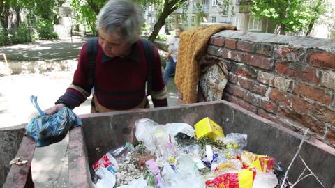Man looking in a trash food Stock Video Footage