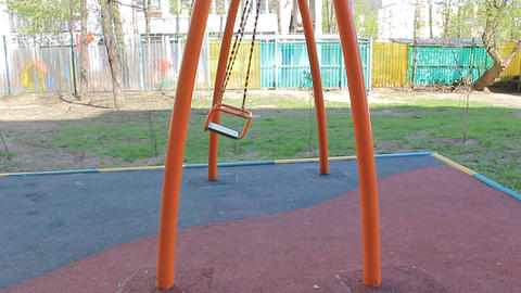 Single swing at the playground Stock Video Footage