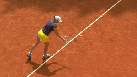 tennis girl blue yellow serve forehand 01 Stock Video Footage