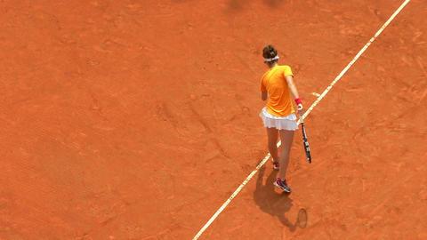 tennis girl orange serve forehand 01 Stock Video Footage