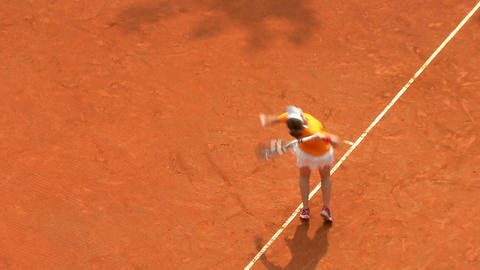 tennis girl orange serve forehand 01 Stock Video Footage