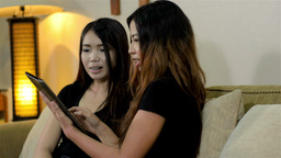 Two Female Friends Playing with a Tablet Computer, Stock Video Footage