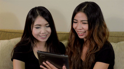Tablet 18Two Asian Friends Video Chatting With A F Footage