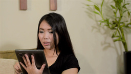 Young Asian Woman With a Tablet Computer at Home Stock Video Footage