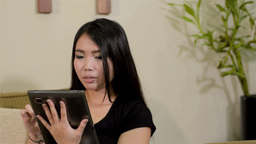 Young Asian Woman With a Tablet Computer at Home Footage