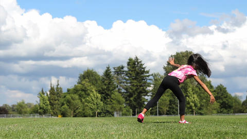 Cute Asian Girl Doing Cartwheels On The Grass Stock Video Footage