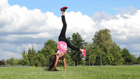 Seven Year Old Girl Doing Cartwheels Footage