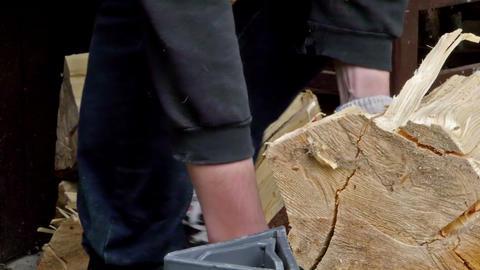 Man using machine that chops wood Stock Video Footage