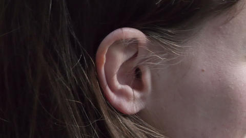 Expose the ear behind the hair Stock Video Footage