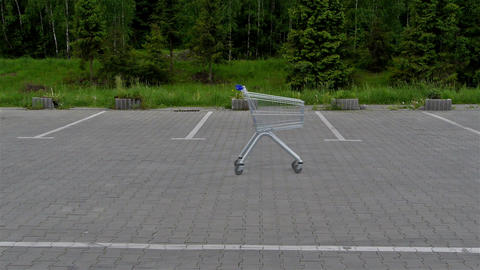 Shopping cart on empty parking lot Stock Video Footage