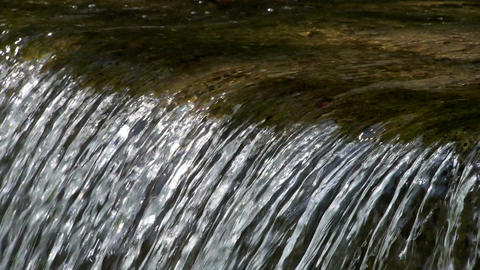 Close up at the threshold of a stream of water Stock Video Footage