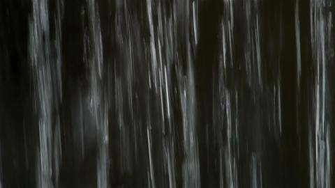 Falling down water on dark background Stock Video Footage
