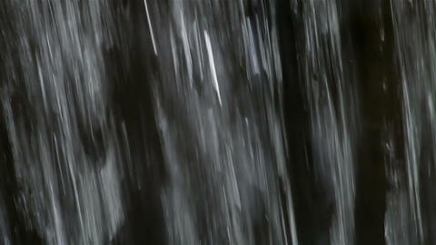 Falling down water on dark background Footage